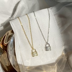 Dainty lock pendant in sterling silver and cubic zirconia