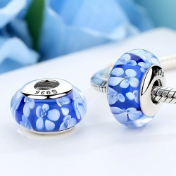 blue glass bead with white flowers
